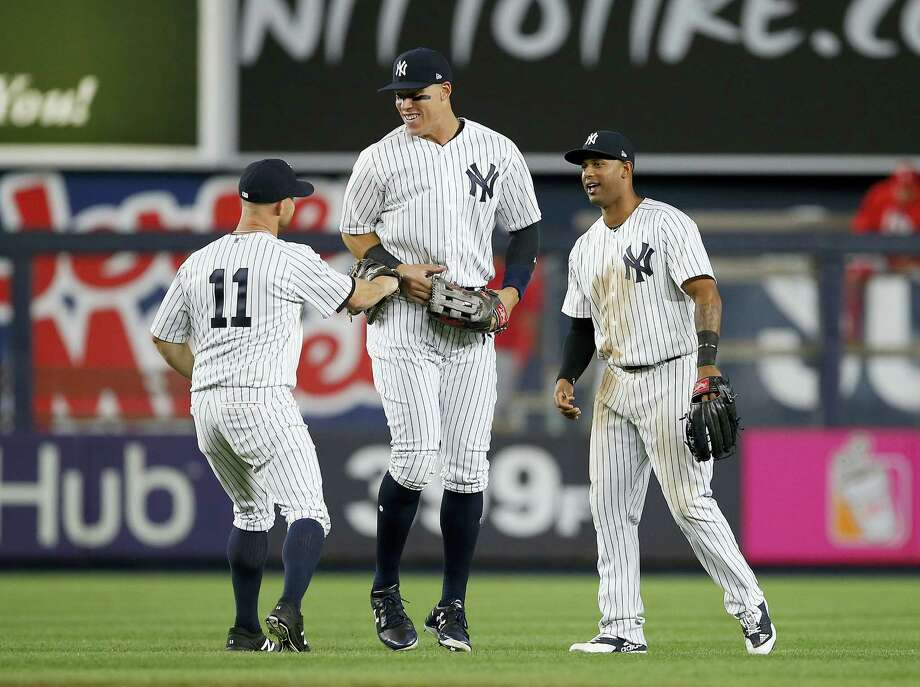 From left, the Yankees' Brett Gardner (11), Aaron Judge and Aaron Hicks celebrate after a win earlier this season. Photo: The Associated Press File Photo   / FR27227 AP