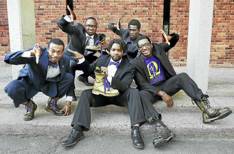 Members of the Chi Omicron and Epsilon Iota Iota Chapters of Omega Psi Phi Fraternity, David Nooks, George Pressley, Malcolm Welfare, David McKinnie and Olafemi Hunter, left to right, talk about the history of stepping in the black community in New Haven. Photo: Catherine Avalone — New Haven Register / Catherine Avalone/New Haven Register