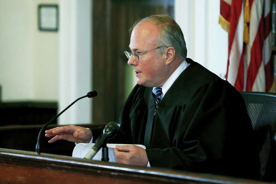 Judge Thomas F. McGuire Jr. addresses attorney George Leontire, representing the family of Aaron Hernandez, and attorney Mary Murray, representing the Department of Corrections, at Bristol Superior Court on Friday, April 21, 2017, in New Bedford, Mass. Judge McGuire on Friday ordered key evidence in the prison suicide of Aaron Hernandez preserved, granting a request from the ex-NFL star's fiancee so the family can investigate the circumstances of his death. Photo: Lisa Hornak/The Boston Herald Via AP, Pool    / ©LisaHornak