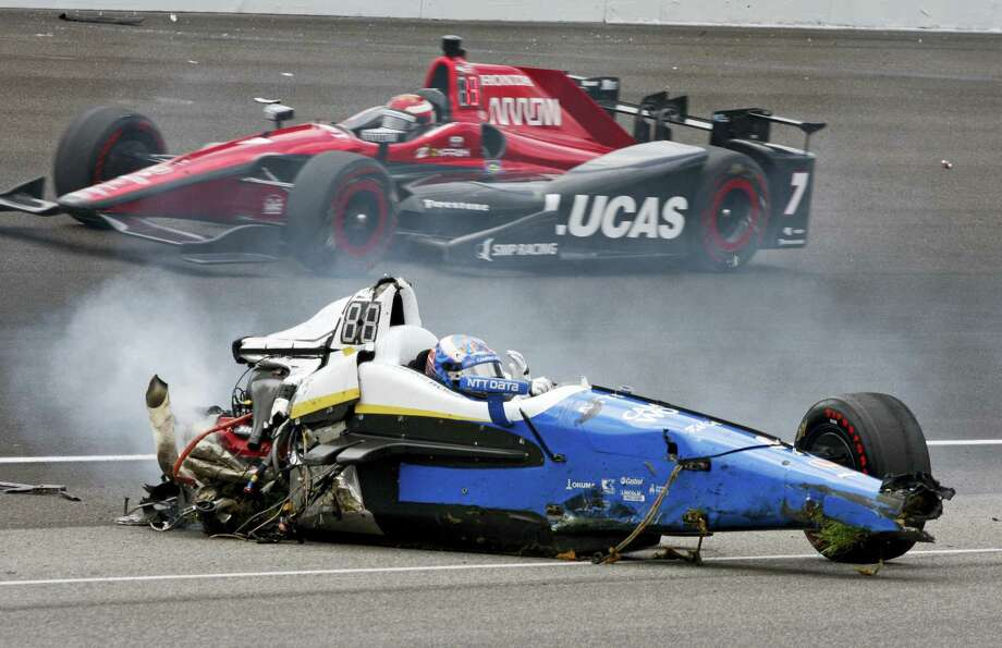 Scott Dixon, of New Zealand, sits in the remains of his car after going airborne in a crash during the running of the Indianapolis 500 auto race at Indianapolis Motor Speedway on Sunday, May 28, 2017 in Indianapolis. Photo: AP Photo — Bud Cunningham   / Copyright 2017 The Associated Press. All rights reserved.