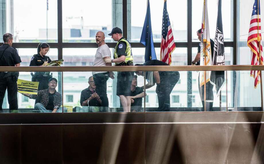 Protesters concerned about the GOP healthcare bill are arrested outside Republican senators' offices on Capitol Hill in Washington, D.C., on June 28. Photo: Washington Post Photo — Melina Mara   / The Washington Post