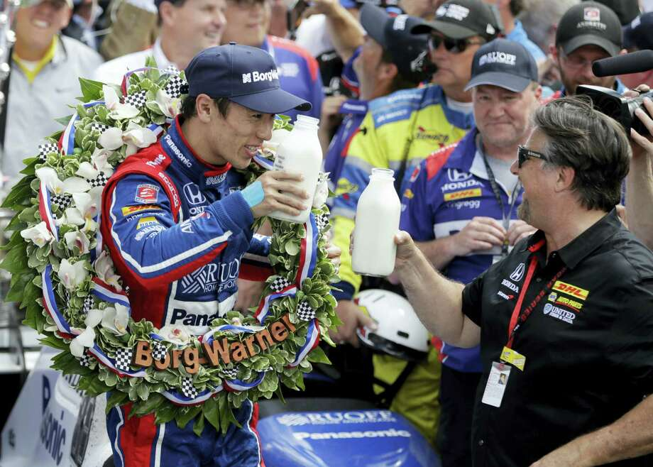 Takuma Sato, left, toasts with car owner Michael Andretti as they celebrate after winning the Indianapolis 500 on Sunday. Photo: Darron Cummings — The Associated Press   / Copyright 2017 The Associated Press. All rights reserved.