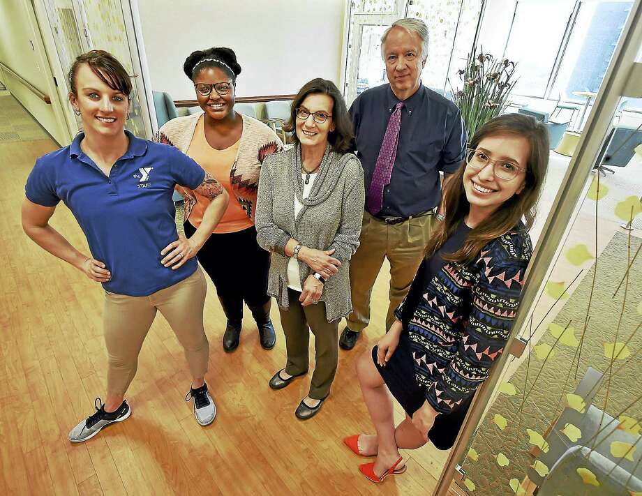 Alisha Williams, director of health and wellness at the Woodruff Family YMCA in Milford; Erika Pugh, research coordinator; Susan Possidente Good, advanced practice registered nurse; Dr. Christopher van Dyck, principal investigator; and Emily Kemp, study coordinator, left to right, at the Alzheimer's Disease Research Unit at Yale School of Medicine at 1 Church St. in New Haven. Photo: Catherine Avalone — New Haven Register    / Catherine Avalone/New Haven Register