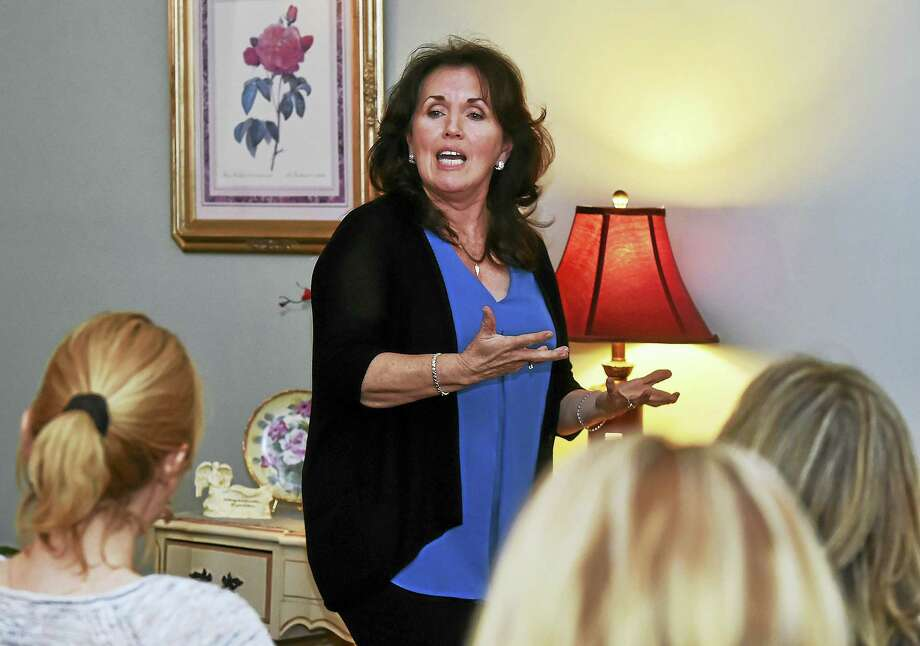 Catherine Crowley, a spiritual medium, reads to the room of 31 women and one man and speaks about life after death at Mystics By the Sea at 394 New Haven Ave. in Milford. Photo: Catherine Avalone — New Haven Register   / Catherine Avalone/New Haven Register