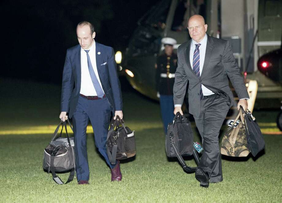 Stephen Miller, senior adviser to President Donald Trump, left, and National Security Adviser H.R. McMaster walk from Marine One across the South Lawn to White House in Washington on May 27, 2017 as they return from Sigonella, Italy with President Donald Trump and first lady Melania Trump. Photo: AP Photo — Carolyn Kaster   / Copyright 2017 The Associated Press. All rights reserved.