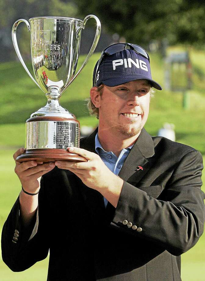 Hunter Mahan holds up the trophy after winning the 2007 Travelers Championship. Photo: The Associated Press File Photo   / AP2007