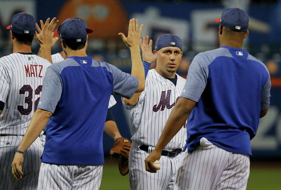 The Mets' Asdrubal Cabrera, second from right, high-fives teammates after they beat the Phillies on Saturday. Photo: Julie Jacobson — The Associated Press   / Copyright 2017 The Associated Press. All rights reserved.
