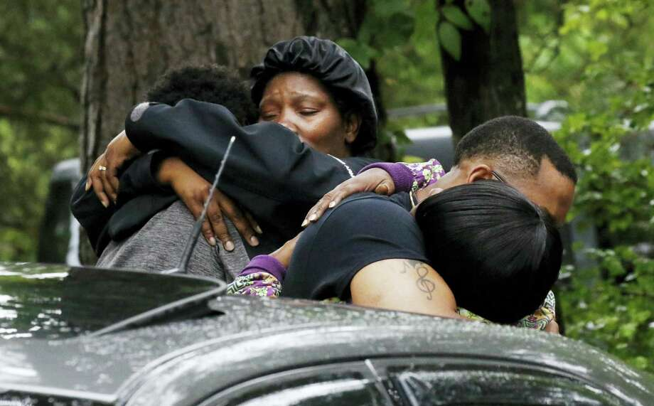 People embrace Sunday, May 28, 2017, outside a Bogue Chitto, Miss., house where several people were fatally shot during a house-to-house shooting rampage Saturday in Lincoln County, Miss. A man was arrested Sunday in the shooting rampage that left several people dead, including a sheriff's deputy. (AP Photo/Rogelio V. Solis) Photo: AP / Copyright 2017 The Associated Press. All rights reserved.
