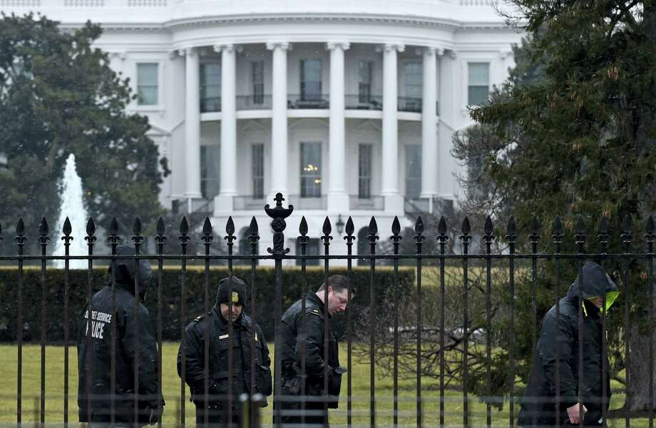 Secret Service officers search the south grounds of the White House in Washington. Photo: Susan Walsh — The Associated Press   / AP