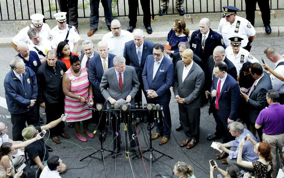 New York Mayor Bill De Blasio, center, talks during a news conference outside of the Bronx Lebanon Hospital Center after reports of a shooting, Friday, June 30, 2017, in New York. Photo: AP Photo/Julio Cortez    / Copyright 2017 The Associated Press. All rights reserved.