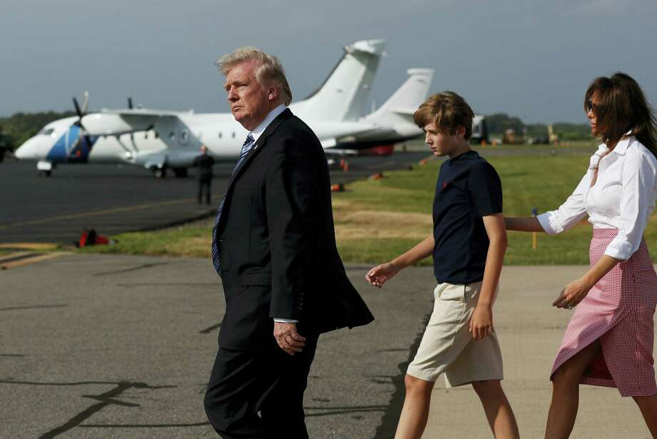President Donald Trump, first lady Melania Trump, and their son Barron Trump, walk across the tarmac to Marine One as they arrive on Air Force One at Morristown Municipal Airport, in Morristown, N.J., Friday, June 30, 2017, en route to Trump National Golf Club in Bedminster, N.J. Photo: AP Photo/Carolyn Kaster    / Copyright 2017 The Associated Press. All rights reserved.