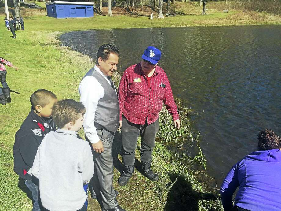 Mayor David Cassetti looks at the action during a past William J. Stokes Memorial Fishing Derby, sponsored by the Ansonia Park and Recreation. Photo: Ansonia City Hall