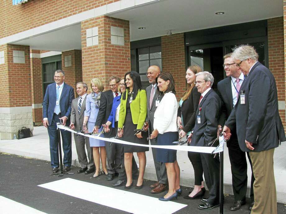 Members of the greater North Haven community, Yale New Haven Health and the Northeast Medical Group prepare to cut the ribbon to formally open the new health care facility at 4 A Devine St. in North Haven recently. Photo: CONTRIBUTED PHOTO/Yale New Haven Health
