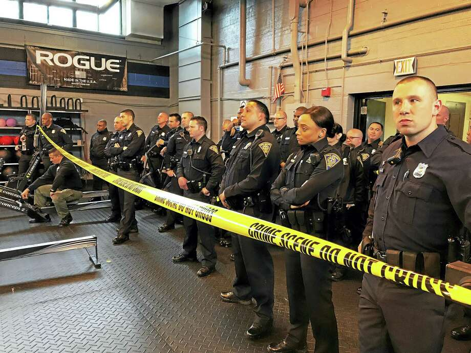 Soon-to-be New Haven police sergeants listen to instructors during a live drill exercise at the Police Academy on Wintergreen Avenue in New Haven Friday. Photo: Esteban L. Hernandez — New Haven Register