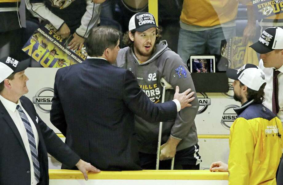 Injured Predators center Ryan Johansen, center, celebrates with coach Peter Laviolette after the Predators beat the Ducks in the Western Conference final. Photo: Mark Humphrey — The Associated Press   / Copyright 2017 The Associated Press. All rights reserved.