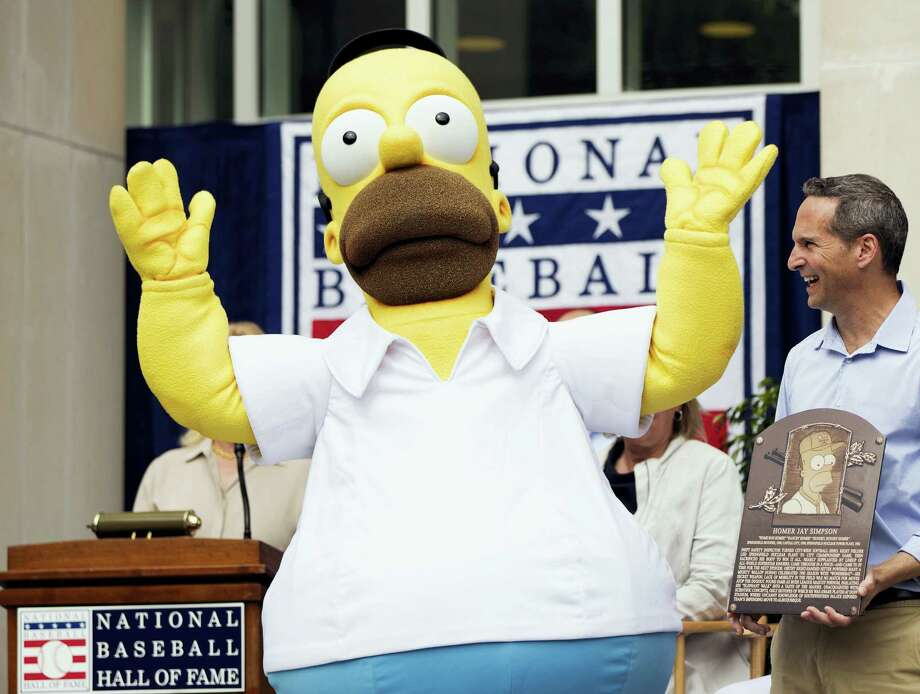 In this photo provided by the National Baseball Hall of Fame and Museum, an actor portraying cartoon character Homer Simpson reacts as the character receives a plaque from the National Baseball Hall of Fame in Cooperstown, N.Y., on Saturday. Photo: Jean Fruth — National Baseball Hall Of Fame And Museum Via AP   / National Baseball Hall of Fame a