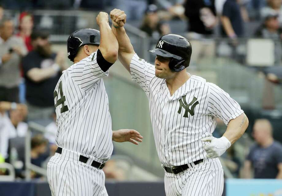 The Yankees' Matt Holliday, right, celebrates with Gary Sanchez, left after hitting a two-run home run in the sixth inning Saturday. Photo: Frank Franklin II — The Associated Press   / Copyright 2017 The Associated Press. All rights reserved.