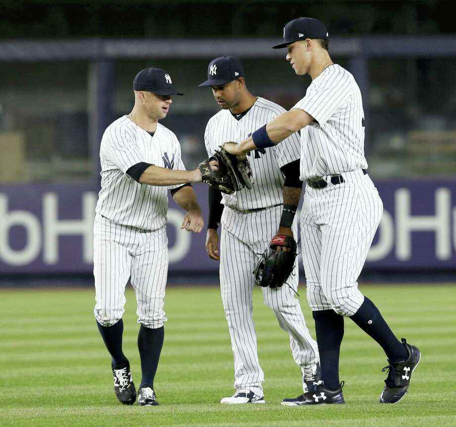 New York Yankees' Brett Gardner, left, Jacoby Ellsbury, center, and Aaron Judge celebrate in the outfield after the baseball game against the Chicago White Sox at Yankee Stadium, Wednesday, April 19, 2017, in New York. The Yankees defeated the White Sox 9-1. (AP Photo/Seth Wenig) Photo: AP / Copyright 2017 The Associated Press. All rights reserved.