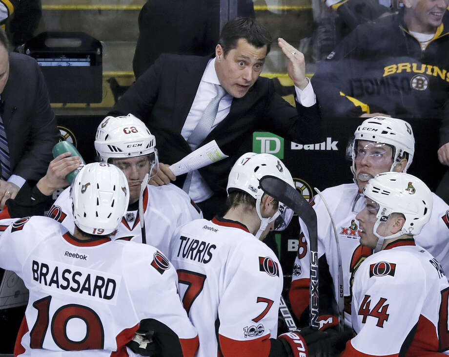 Ottawa Senators head coach Guy Boucher talks to his players during a time out by the Boston Bruins in the third period of Game 4 of a first-round NHL hockey playoff series in Boston, Wednesday, April 19, 2017. The Senators defeated the Bruins 1-0. (AP Photo/Charles Krupa) Photo: AP / Copyright 2017 The Associated Press. All rights reserved.