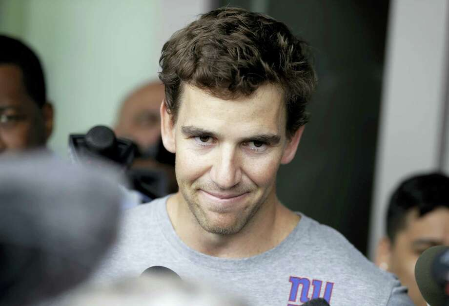 Giants quarterback Eli Manning talks to reporters during an availability Thursday in East Rutherford, N.J. Photo: Julio Cortez — The Associated Press   / Copyright 2017 The Associated Press. All rights reserved.