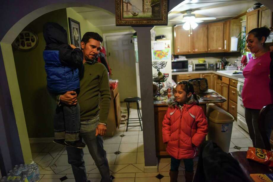 Selfo Soto holds up his son at the family's home at the East End Mobile Home Park in Manassas, Va. Photo: Michael Robinson Chavez — The Washington Post   / The Washington Post