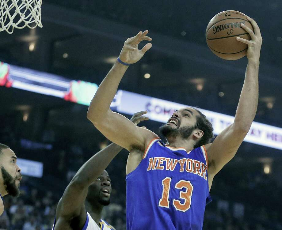 In this file photo, New York Knicks' Joakim Noah, right, shoots against Golden State Warriors' Draymond Green, center, and JaVale McGee during the first half of an NBA basketball game in Oakland Brandon Jennings is gone and Joakim Noah is headed for knee surgery. If the New York Knicks are going to make a playoff push, it will come without two of the key veterans they signed last summer. Photo: Ben Margot — The Associated Press File   / Copyright 2017 The Associated Press. All rights reserved.