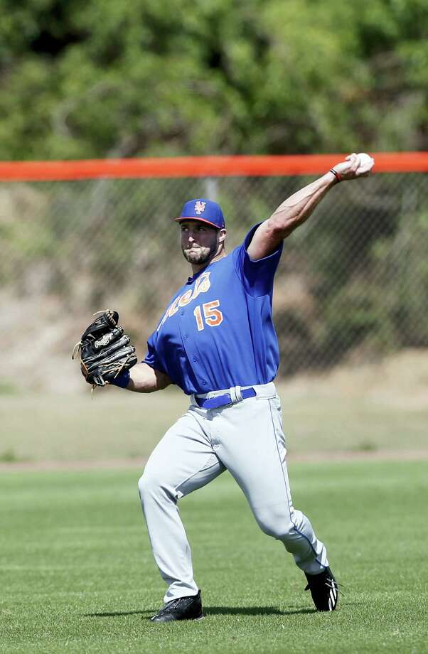 Former NFL quarterback and New York Mets outfielder Tim Tebow works during a spring training baseball practice Monday in Port St. Lucie, Fla. Photo: John Bazemore — The Associated Press   / Copyright 2017 The Associated Press. All rights reserved.