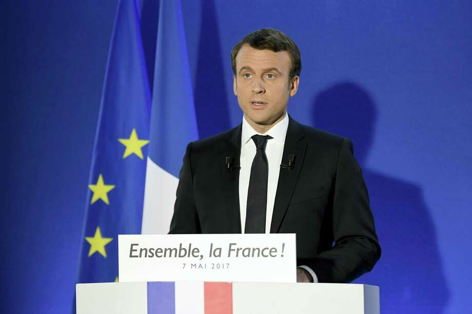 Incoming French president Emmanuel Macron speaks after his victory in presidential runoff, at his campaign headquarters in Paris, Sunday, May 7, 2017. French voters elected centrist Emmanuel Macron as the country's youngest president ever on Sunday, delivering a resounding victory to the unabashedly pro-European former investment banker and strengthening France's place as a central pillar of the European Union. (Lionel Bonaventure/Pool Photo via AP) Photo: AP / AFP or licensors