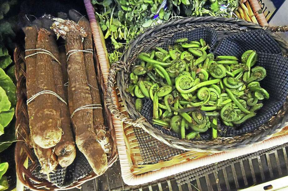 Organic vegetables at Thyme & Season Natural Food Market at 3040 Whitney Ave. in Hamden, Thursday May 18, 2017, celebrates 20th anniversary. Photo: Catherine Avalone — New Haven Register   / Catherine Avalone/New Haven Register