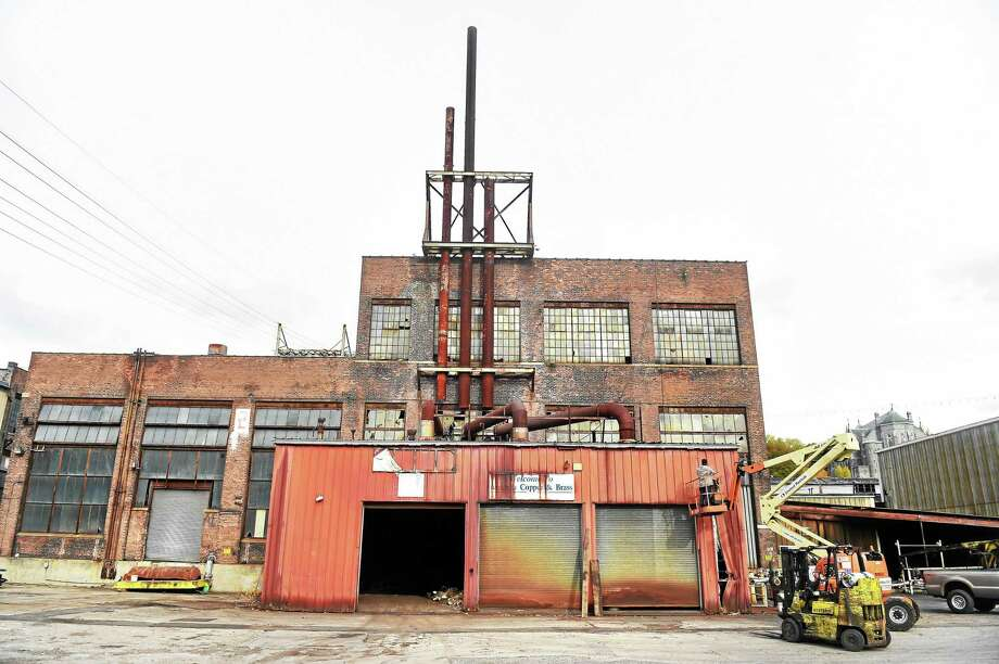 Three smoke stacks were being removed at the Ansonia Copper & Brass facility in Ansonia in this 2015 photo. Photo: Arnold Gold — New Haven Register File Photo