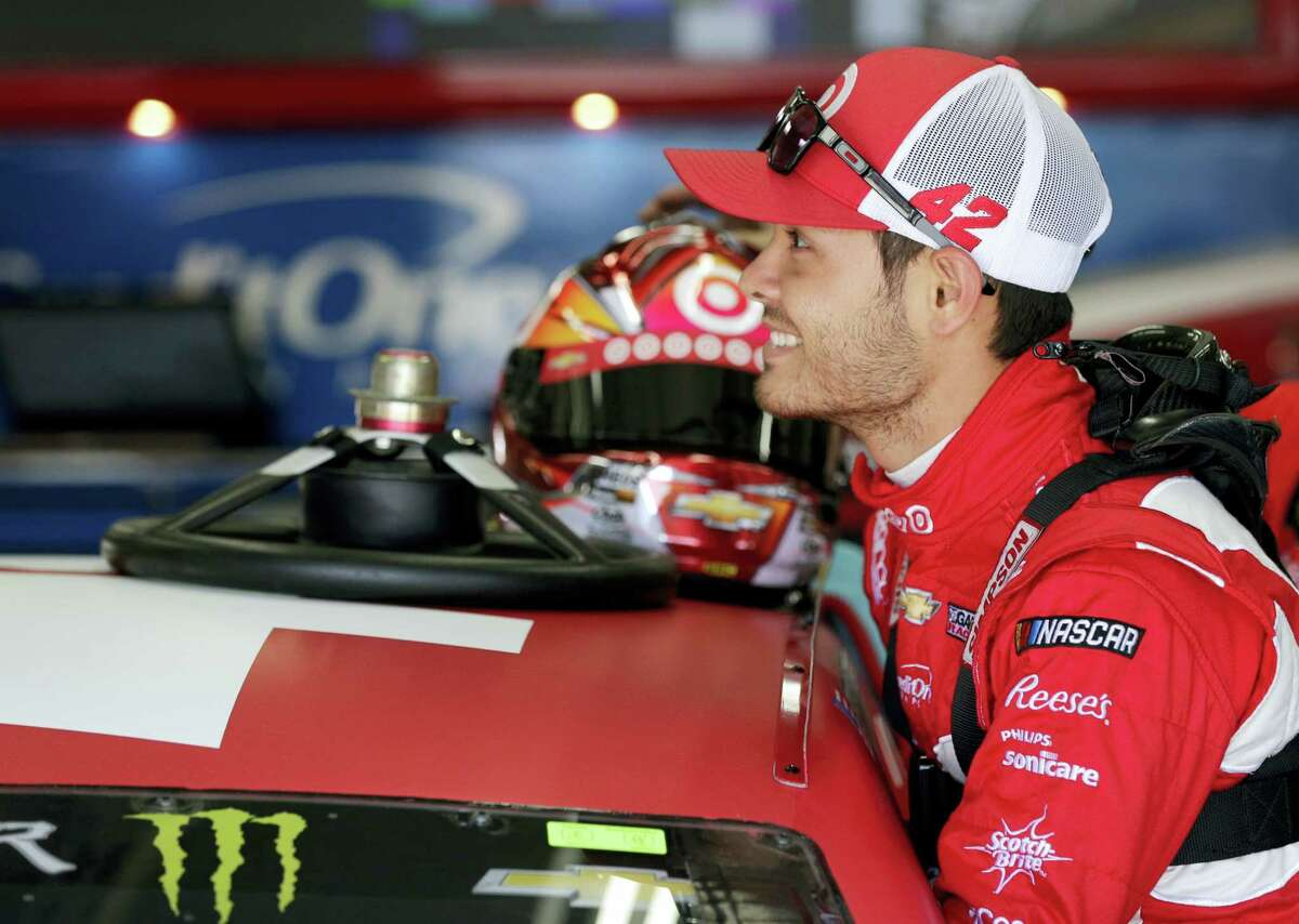 Kyle Larson smiles as he climbs into his car before a recent practice.