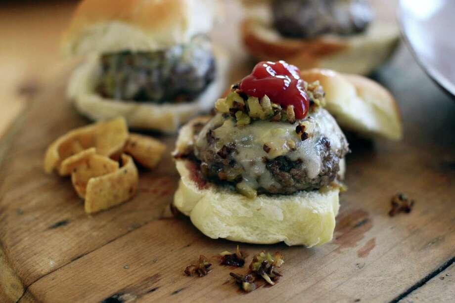 Beer-steamed cheese and mushroom beef sliders. Photo: Matthew Mead — The Associated Press   / FR170582 AP