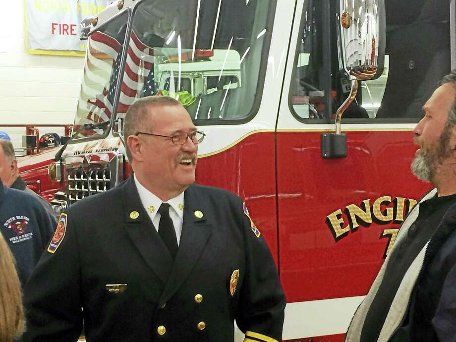 Wallingford Fire Chief Richard Heidgerd shares a laugh with a resident at a ceremony Thursday celebrating the town's new North Farms Volunteer Fire Department Station. Photo: Luther Turmelle — New Haven Register