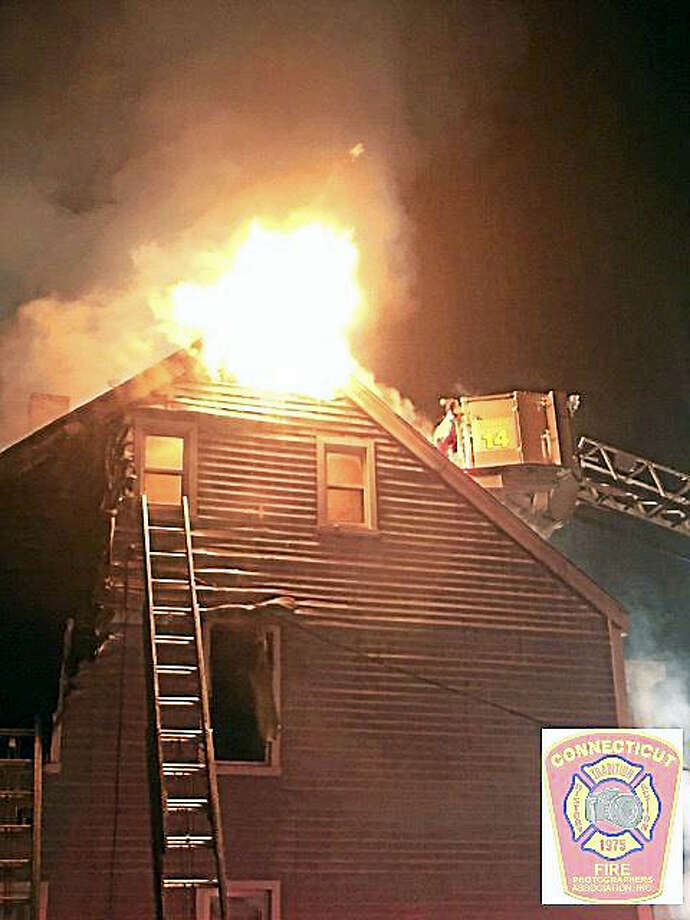 Firefighters battle a blaze at 165 West St. Photo: Katie Matto — Connecticut Fire Photographers Association