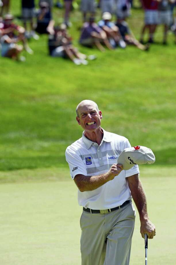 Jim Furyk celebrates after shooting a course and PGA-record 58 during the final round of LAST YEAR'S Travelers Championship golf tournament in Cromwell.Furyk will return to play in this year's event in June. Photo: FRED BECKHAM — THE ASSOCIATED PRESS   / FR153656 AP