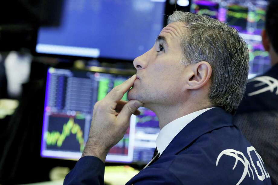 Specialist Anthony Rinaldi works at his post on the floor of the New York Stock Exchange, Tuesday, June 27, 2017. Stocks are opening slightly lower on Wall Street, led by declines in phone and technology companies. Photo: Richard Drew / AP Photo   / AP