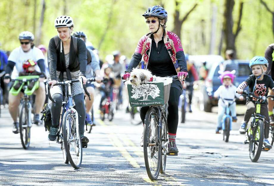 Katrina Clark, center, of New Haven, with her dog Kaycie, begins the 8-mile ride in the Rock to Rock Earth Day Ride at West Rock Park in New Haven in 2016. Photo: Arnold Gold — New Haven Register FILE PHOTO