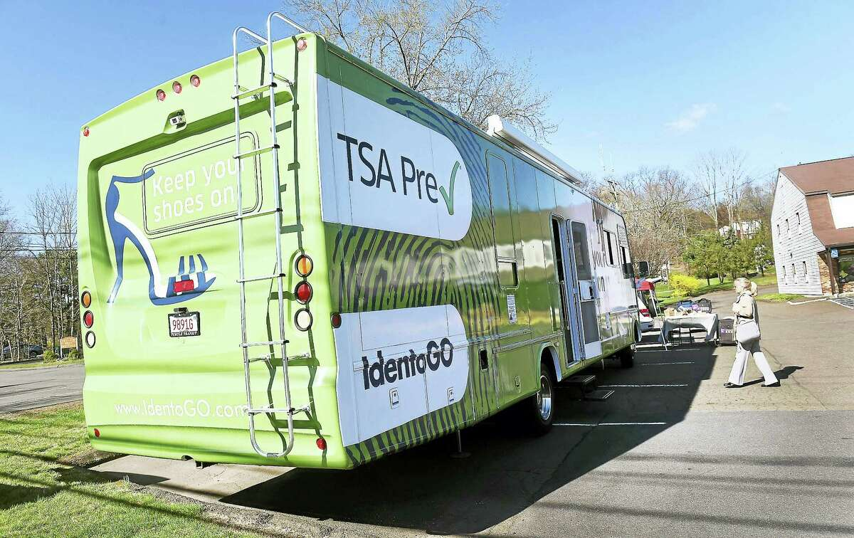 A TSA IdentoGO vehicle is parked at 1111 S. Main St. in Cheshire Friday to enroll people in the TSA PreCheck program.