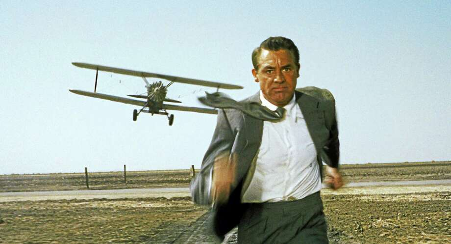 "Cary Grant in the famous crop duster scene from ""North by Northwest."" Photo: Contributed"