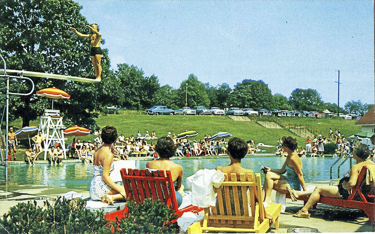 "Hilton's Resort postcard, 1960. On reverse: ""Forgotten are the cares of a work-a-day world when you slip into the clear sparkling filtered pool at Hilton's."""