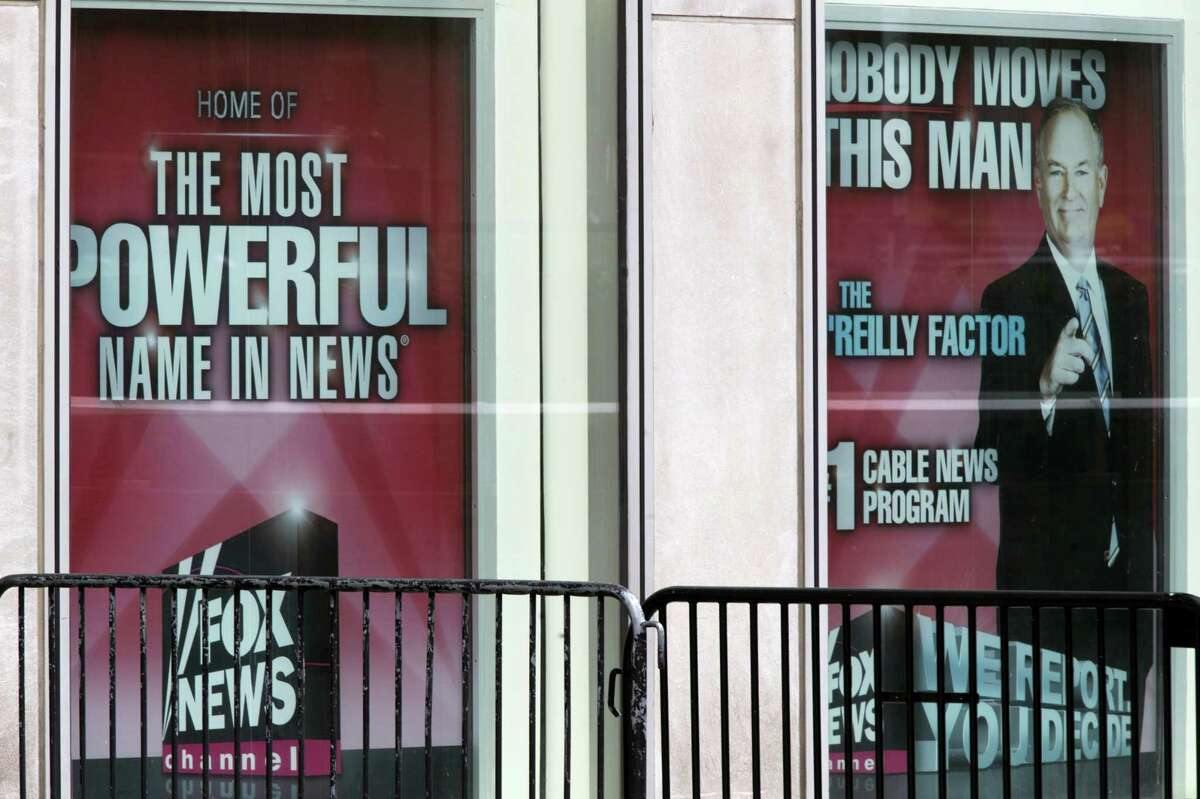Posters featuring Bill O'Reilly are displayed at the News Corp. headquarters in Midtown Manhattan on April 19, 2017. O'Reilly has lost his job at Fox News Channel after allegations that he sexually harassed women.