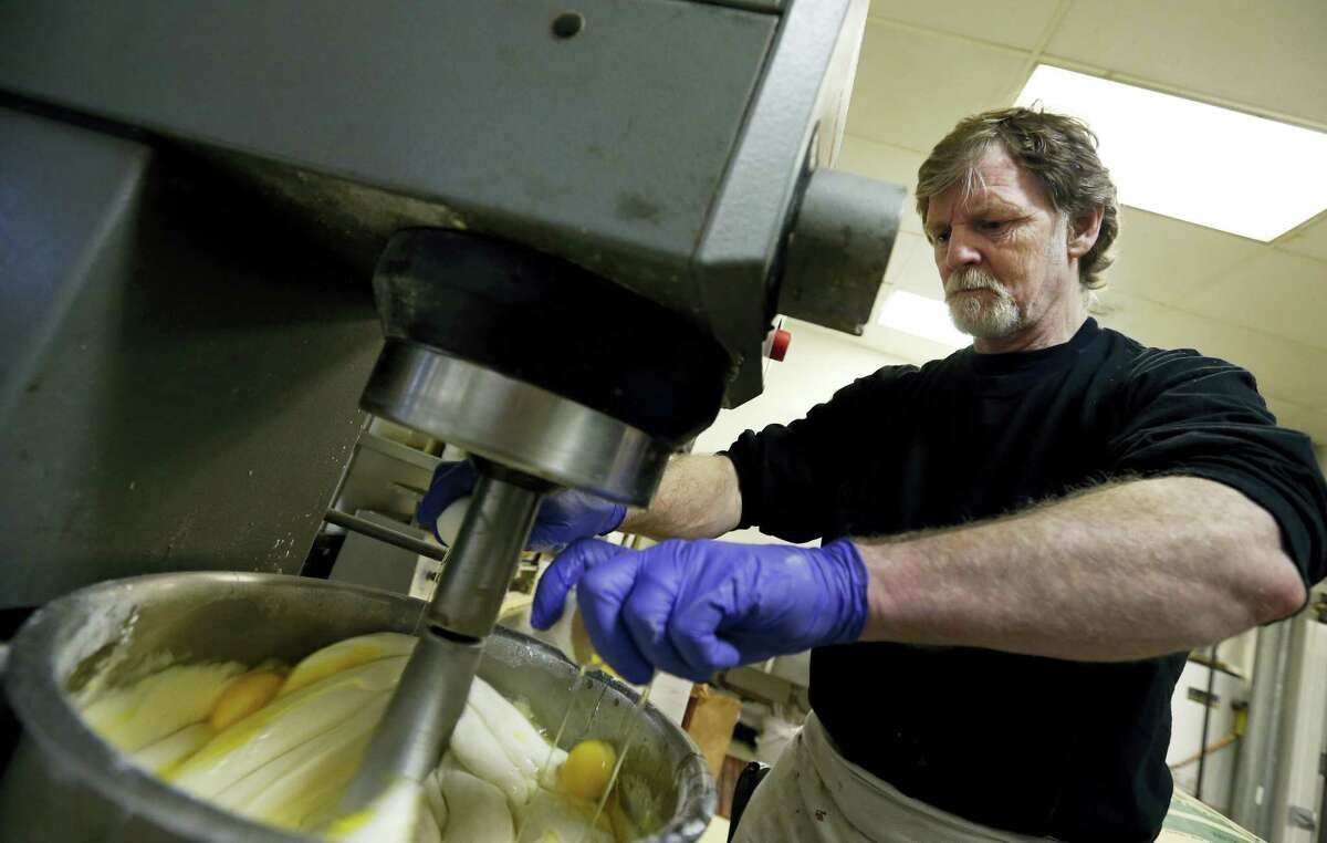 In this file photo, Masterpiece Cakeshop owner Jack Phillips cracks eggs into a cake batter mixer inside his store in Lakewood, Colo. The Supreme Court is taking on a new clash between gay rights and religion in a case about a wedding cake for a same-sex couple in Colorado. The justices said Monday they will consider whether a baker who objects to same-sex marriage on religious grounds can refuse to make a wedding cake for a gay couple.