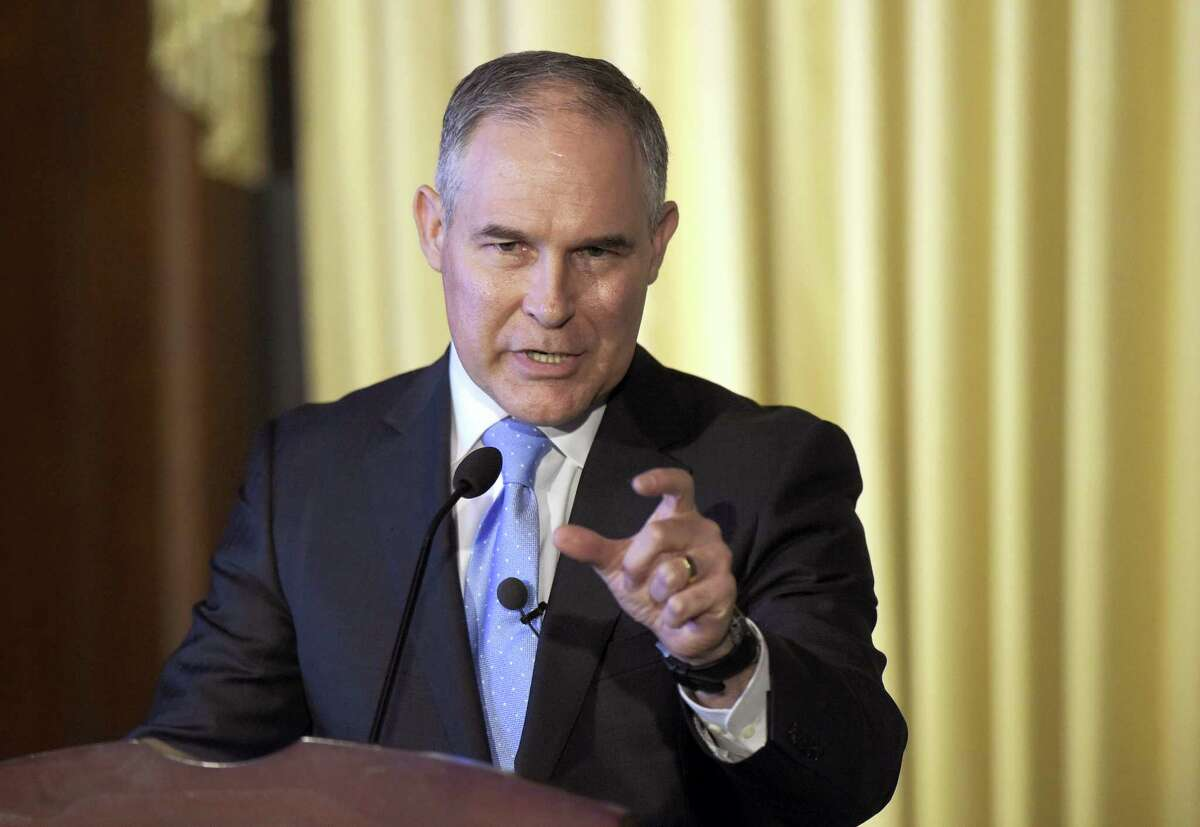 "FILE - In this Feb. 21, 2017, file photo, Environmental Protection Agency (EPA) Administrator Scott Pruitt speaks to employees of the EPA in Washington. Dow Chemical is pushing the Trump administration to scrap the findings of federal scientists who point to a family of widely used pesticides as harmful to about 1,800 critically threatened or endangered species. Lawyers representing Dow and two other makers of organophosphates sent letters last week to the heads of three Cabinet agencies. The letters, obtained by The Associated Press, show the companies asked them ""to set aside"" the results of government studies. (AP Photo/Susan Walsh, File)"