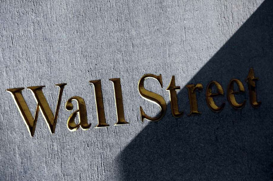 A sign for Wall Street on the side of building near the New York Stock Exchange. Photo: Mark Lennihan — The Associated Press File   / Copyright 2016 The Associated Press. All rights reserved. This material may not be published, broadcast, rewritten or redistribu