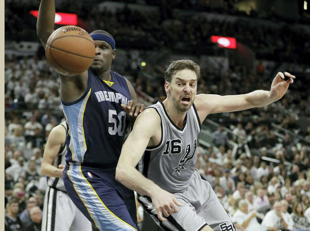 Memphis Grizzlies forward Zach Randolph (50) and San Antonio Spurs center Pau Gasol (16) chase a loose ball during the first half Game 1 in a first-round NBA basketball playoff series April 15, 2017 in San Antonio.