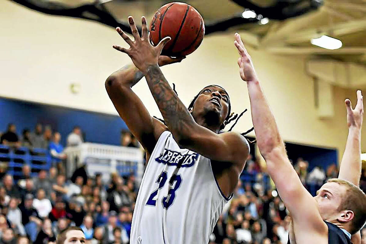 Hartford's Jaqhawn Walters led Albertus Magnus in scoring and rebounding this season and was the MVP of the GNAC tournament. Photo by: Ron Waite