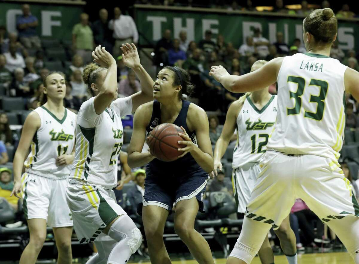 Connecticut guard/forward Napheesa Collier (24) goes up against South Florida guard/forward Ariadna Pujol (11), forward Tamara Henshaw (23), forward Maria Jespersen (12), and forward Kitija Laksa (33) during the second half of an NCAA women's college basketball game Monday in Tampa, Fla. UConn won the game 96-68.