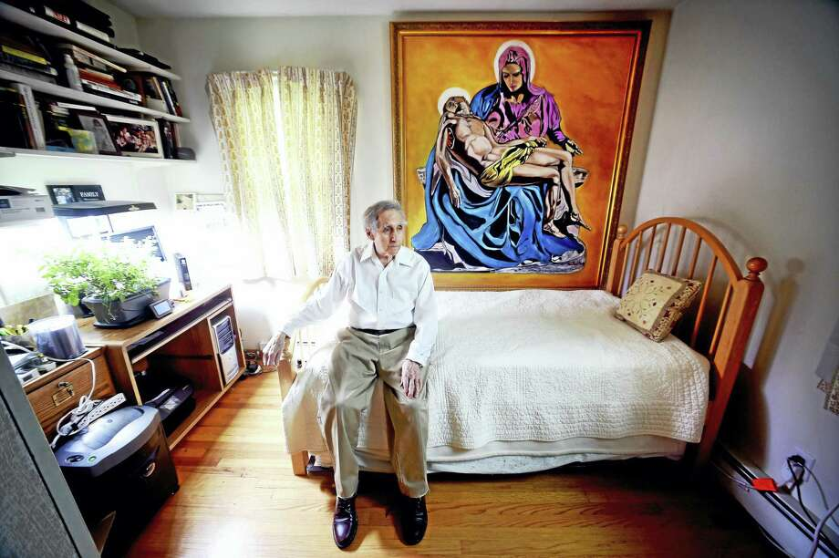 Ralph Milione, 91, is photographed at his home in New Haven in front of his painting inspired by Michelangelo's Pieta. Photo: Arnold Gold — New Haven Register