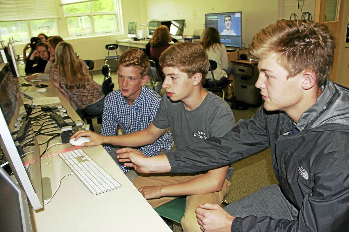 From left, Carter Soboleski, Kyle Citrin and Clay Knibbs view their award-winning video on editing software at Daniel Hand High School.