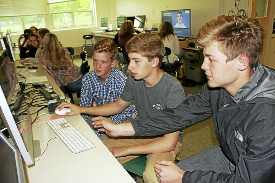 From left, Carter Soboleski, Kyle Citrin and Clay Knibbs view their award-winning video on editing software at Daniel Hand High School. Photo: Anna Bisaro — New Haven Register